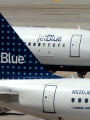 JetBlue will reduce the number of seats it blocks after Dec. 1 to accommodate families traveling together over the holidays.