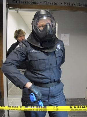 Colchester Police Chief Jennifer Morrison wears a protective helmet during an active shooter training session Tuesday at the University of Vermont. At rear is UVM Police Chief Lianne Tuomey, one of the instructors.
