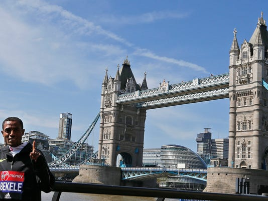 """FILE- In this Wednesday, April 20, 2016 file photo, Kenensia Bekele of Ethiopia poses for photographers ahead of the London marathon at the Tower Bridge in London. Bekele says his exclusion from Ethiopia's marathon team for the Olympics is """"unjust"""" and has called the selection criteria the national federation used """"biased"""". (AP Photo/Frank Augstein, file)"""
