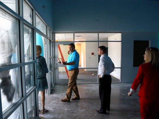 Superintendent Roland Hernandez from the Corpus Christi Independent School District view tours Calk-Wilson Elementary School with school board members Tuesday, June 13, 2017, in Corpus Christi.