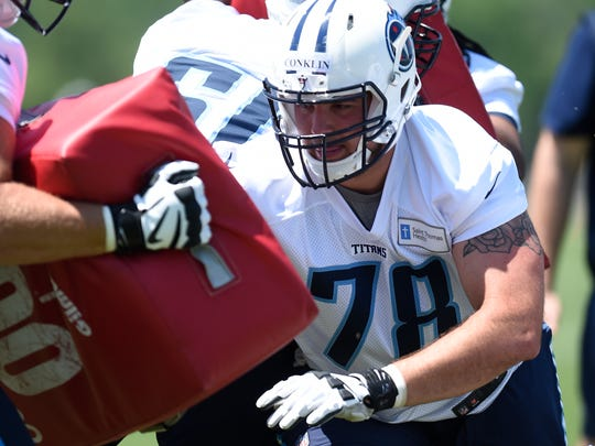 Titans offensive lineman Jack Conklin (78) powers through a drill during rookie practice May 12.