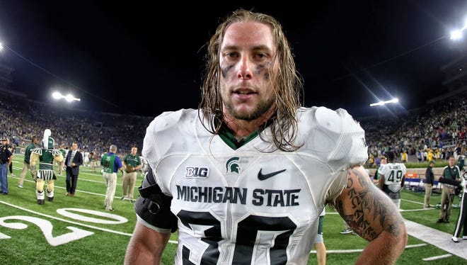 Sep 17, 2016; South Bend, IN, USA; Michigan State Spartans linebacker Riley Bullough walks off the field after a 36-28 win over the Notre Dame Fighting Irish at Notre Dame Stadium.