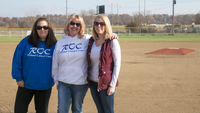 (Left to right) Dawn Hite , Jenni Yoder, and Kristi Risner are helping organize the Turkey Tourney Fall Softball Tournament at the Cyclops Field of Dreams this Saturday. The event will honor fallen Mansfield Police Officer Brian Evans and former softball player and coach Ron Laughlin.