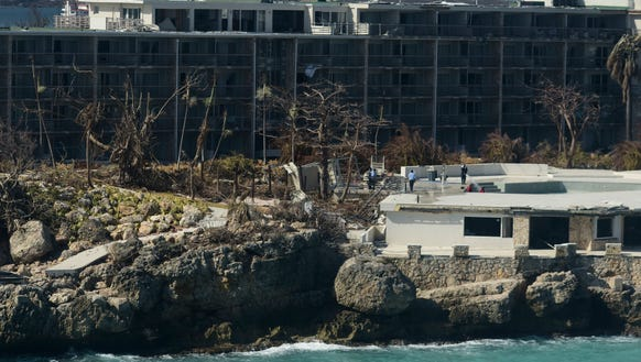 A damaged hotel stands after the passage of Hurricane
