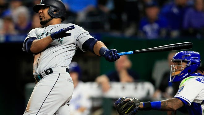 Seattle Mariners first baseman Edwin Encarnacion hits a three-run home run off Kansas City Royals relief pitcher Kevin McCarthy during the sixth inning of a baseball game at Kauffman Stadium in Kansas City, Mo., Monday, April 8, 2019. It was the second home run of the inning for Encarnacion. (AP Photo/Orlin Wagner)