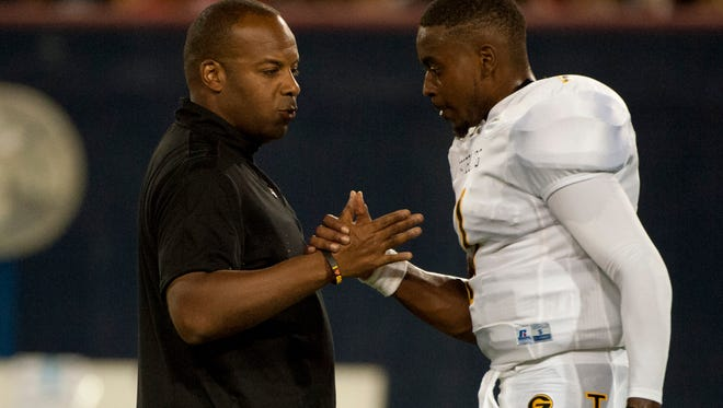 Grambling State Tigers head coach Broderick Fobbs shakes hands with quarterback DeVante Kincade (1) before playing the Arizona Wildcats at Arizona Stadium. Mandatory Credit: Casey Sapio-USA TODAY Sports