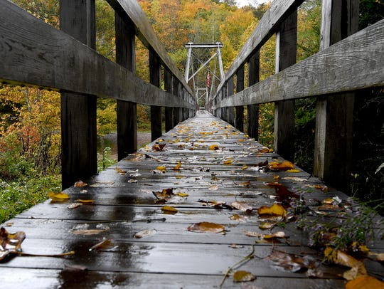 A swinging bridge allows brave hikers to walk across
