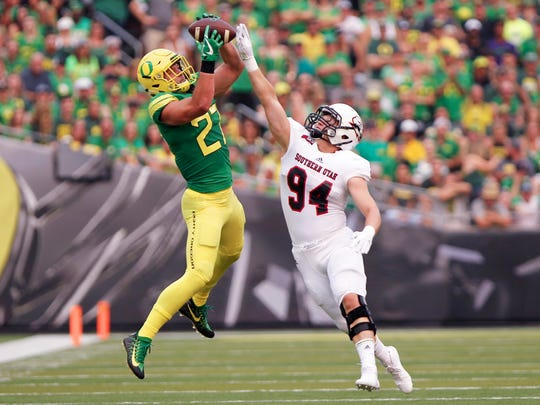 Sep 2, 2017; Eugene, OR, USA; Oregon Ducks tight end Jacob Breeland (27) goes up for a catch over Southern Utah Thunderbirds linebacker Taylor Nelson (94) in the first half at Autzen Stadium. Mandatory Credit: Jaime Valdez-USA TODAY Sports