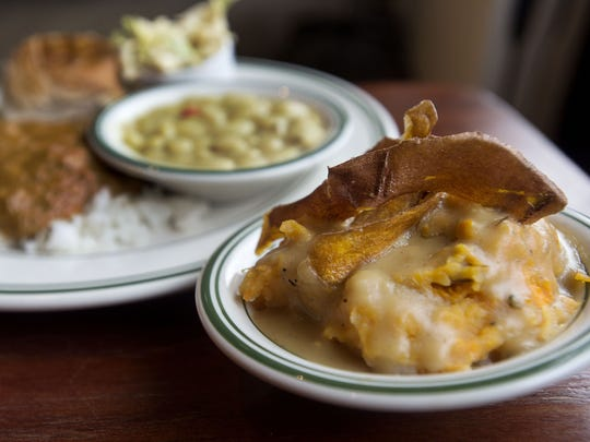 A root vegetable mash covered in gravy is one of the many sides served up at Buxton Hall.