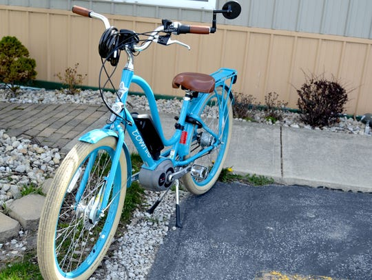 Jay Willmeth's blue motor-assisted Townie is as recognizable