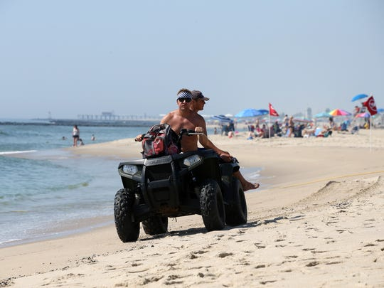 Lifeguards ride along the beach near LaReine Avenue in Bradley Beach, NJ Monday July, 2, 2018. Temperatures are expected to climb into the high 90s again today.