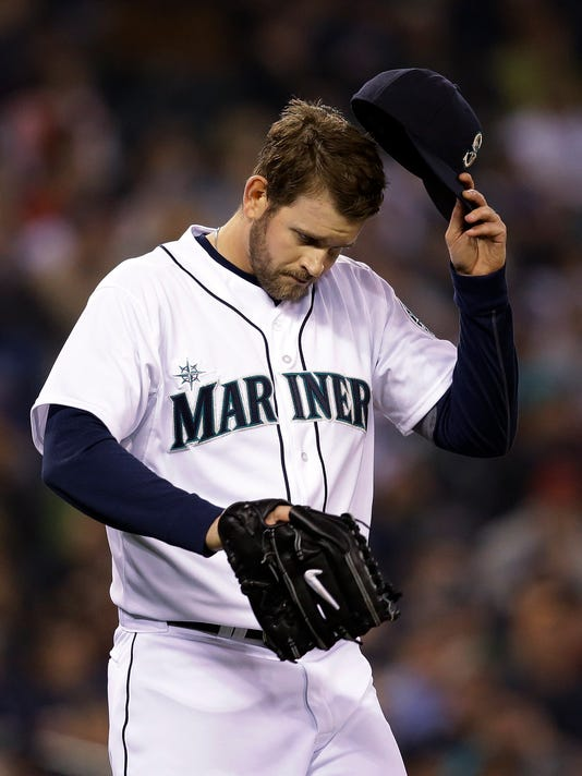 Seattle Mariners starting pitcher James Paxton turns away from the plate after giving up a two-run home run to Los Angeles Angels' Albert Pujols in the first inning Tuesday, April 8, 2014, in Seattle. (AP Photo/Elaine Thompson)