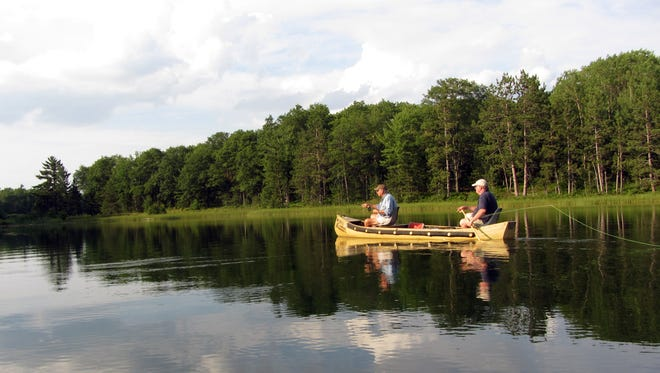 A pair of anglers enjoy a perfect evening of fly fishing.