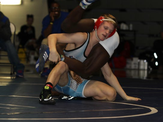Payne Carr wrestles with his opponent.  Carr took second place during the competition.