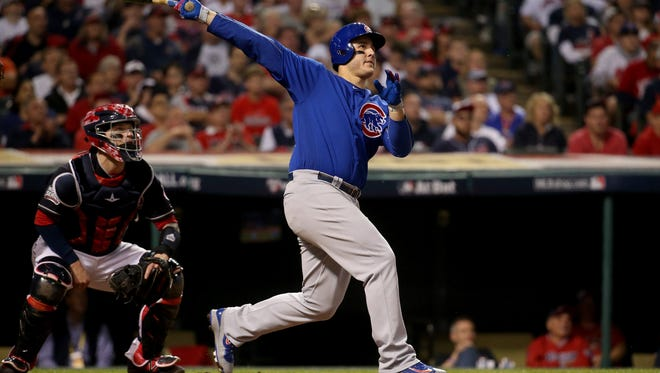 The Chicago Cubs' Anthony Rizzo hits a two-run home run in the ninth inning against the Cleveland Indians on Tuesday, Nov. 1, 2016, in Game 6 of the World Series at Progressive Field in Cleveland. The Cubs won, 9-3, to force a Game 7 on Wednesday.