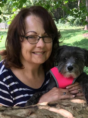 Author Kathleen Jones takes a break from writing with her dog, Lola.