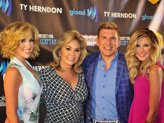 Reality TV stars Julie and Todd Chrisley, center, at