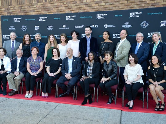 The Montclair Film Board pose for a photo during opening night of the Montclair Film Festival held at the Welmont Theater in Montclair.