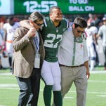 New York Jets cornerback Dee Milliner is helped off the field with an ankle injury against the Denver Broncos on Sunday. Milliner will miss the rest of the season.