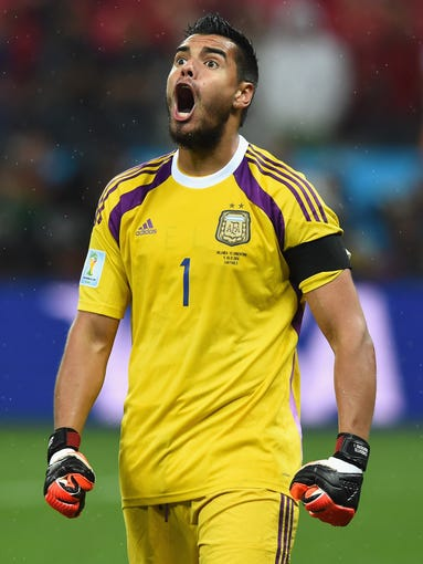 SAO PAULO, BRAZIL - JULY 09:  Sergio Romero of Argentina celebrates saving the penalty kick of Wesley Sneijder of the Netherlands (not pictured) in a shootout during the 2014 FIFA World Cup Brazil Semi Final match between the Netherlands and Argentina at Arena de Sao Paulo on July 9, 2014 in Sao Paulo, Brazil.  (Photo by Matthias Hangst/Getty Images)