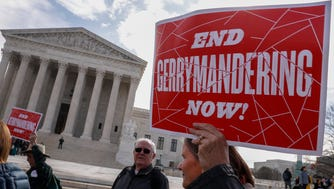 Demonstrators protest outside the Supreme Court in March as the justices heard the second of two challenges to partisan gerrymandering.