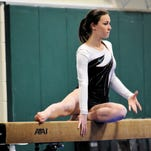 Northville's Claire Cotter, shown in an earlier meet on the balance beam, took sixth in the KLAA meet in the Division 2 uneven bars.