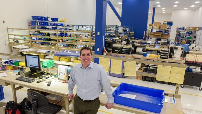 Rich Curran is president of Perma Pure, which recently moved from Toms River to Lakewood. He is pictured in the main assemply floor.
