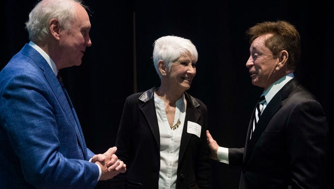 "2018 laureate Robert M. ""Robbie"" Kent, from left, 2011 laureate Patricia Koch and 2018 laureate Steven E. Chancellor talk during the Evansville Regional Business Hall of Fame breakfast at the Old National Events Plaza on Thursday, March 15, 2018. Koch was representing her late husband and 2018 laureate William Albert ""Bill"" Koch Sr."