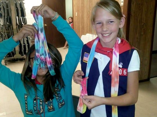 Members of American Heritage Girls troop 2206 work on their textile arts badges.