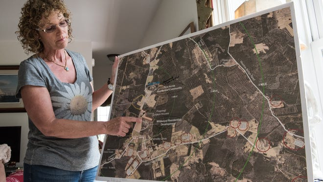 Lisa Inzerillo, of Backbone Road, explains the scope and scale of area chicken farms using an enlarged Google Earth map on Tuesday, May 31, 2016.