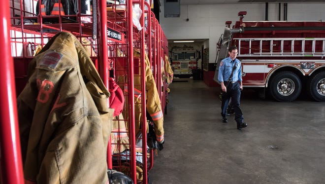 A firefighter from Station One walks through the firehouse after performing a routine cleaning detail on Friday, Feb. 24, 2017.