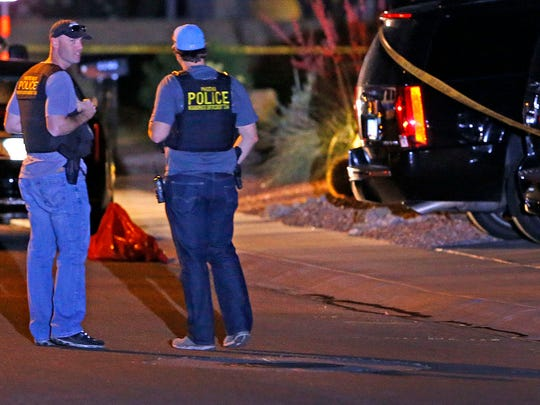 Phoenix police investigate a multiple homicide in the 4300 block of East Anderson Drive Thursday, April 16. 2015 in Phoenix, Ariz