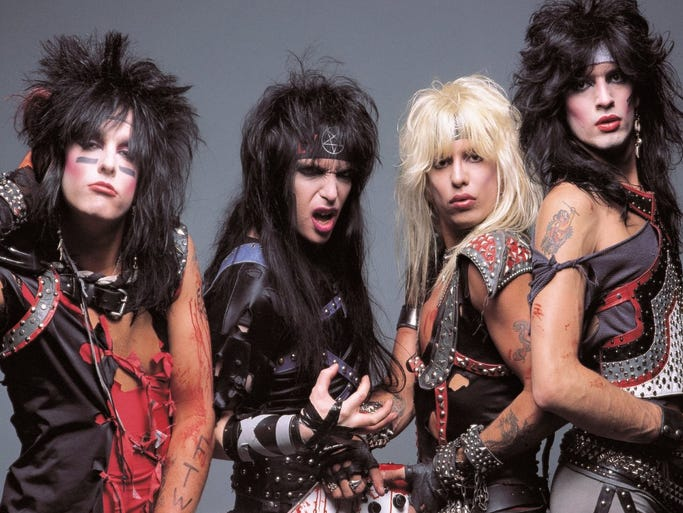 """Motley Crue (from left, Nikki Sixx, Mick Mars, Vince Neil and Tommy Lee) is pictured in a 1980s-era photo. As part of the rock band's """"Final Tour,"""" Motley Crue will perform on July 5 at Klipsch Music Center."""