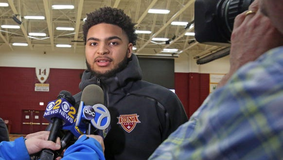 Iona's E.J. Crawford talks to the media at Iona College