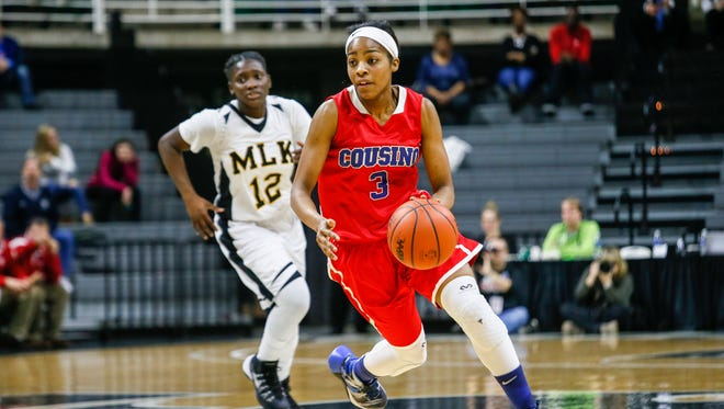 Warren Cousino's Kierra Fletcher drives the ball on a fast break against Detroit Martin Luther King during the MHSAA girls basketball Class A finals at the Breslin Center in East Lansing on Saturday, March 19, 2016.