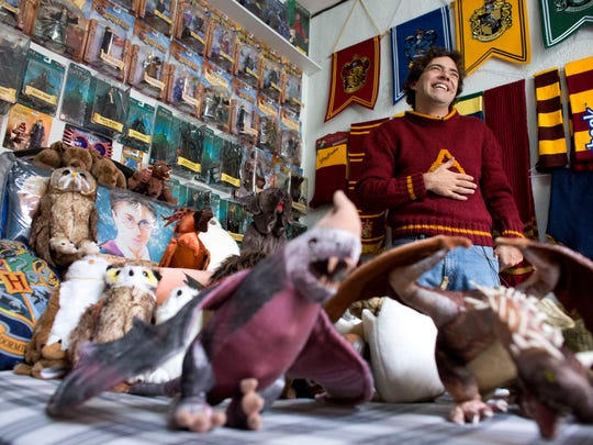 Menahem Asher Silva Vargas, 37, a lawyer, shows off his collection of Harry Potter memorabilia Sept. 29, after being awarded the Guinness World Record title for the largest collection, in Mexico City.