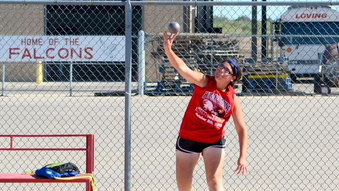 Loving's Tianna Lopez continues her training in the shot put during Wednesday's practice. Lopez will take part in that event at this week's 3A state championships.