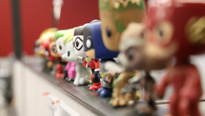 Funko Pop! vinyl figures overlook Matthew's desk at The Spectrum offices in St. George.