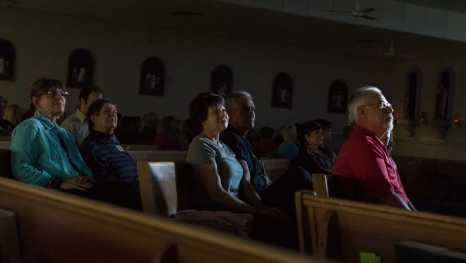 Spectators at Holy Cross Catholic Church in Las Cruces view a live broadcast of the Mass with Pope Francis, which took place in Juárez on Wednesday.