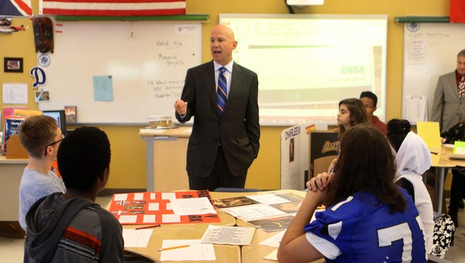 Delaware Gov. Jack Markell speaks to students in a freshman World History honors class Wednesday at Dover High School about the need for them to challenge themselves. Markell and Secretary of Education Steve Godowsky were at DHS to highlight the progress of a statewide effort to ensure more high school students have access to college-level courses.