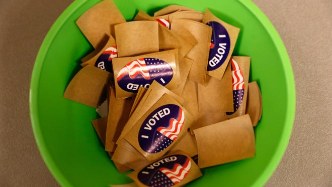 """A container of """"I voted"""" stickers sits on a desk at the Farmington Civic Center on Tuesday."""