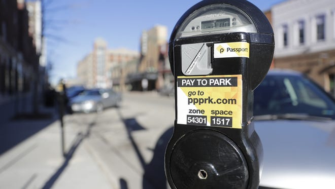 A parking meter on the west side of the 100 block of Washington Street in downtown Green Bay.