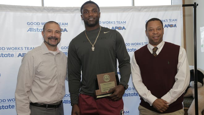 Florida State redshirt tight end Mavin Saunders (center) was named to the 2017 Allstate AFCA Good Works Team on Wednesday afternoon at at John G. Riley Elementary School.