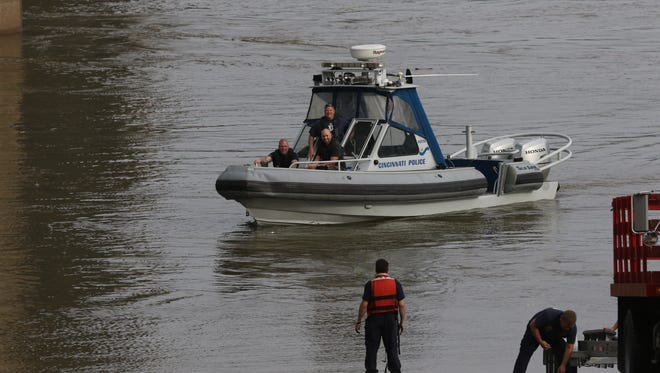 Cincinnati Police Department boat on The Ohio River after reports of a woman who jumped from bridge. The woman was found and transported for treatment.