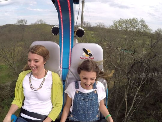 Courtney Cops and her daughter Alyssa enjoy the views from high above thanks to the Nashville Zoo's newest adventure, Soaring Eagle, which officially open to the public Friday March 18. The seated zip line takes guests on a 110 foot high experience with views of the Zoo property and Nashville skyline. Riders then glide back to the ground at speeds up to 28 mph. Seen Thursday March 17, 2016, in Nashville, Tenn.