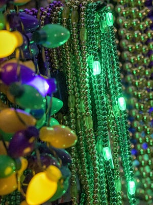 Lighted beads are displayed at the Leesburg Mardi Gras parade in downtown Leesburg on Saturday, Feb. 15, 2020.