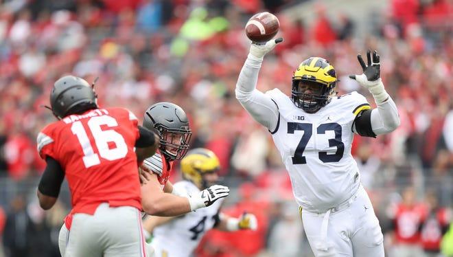 Michigan's Mo Hurst tips a pass thrown by OSU's J.T. Barrett in 2016.