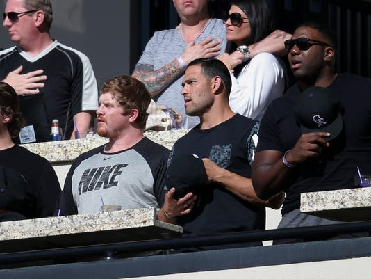 From left, Denver Broncos offensive linemen Ty Sambraillo and Matt Paradis join quarterback Mark Sanchez and offensive tackle Russell Okung in the Mountain West Club to watch the Colorado Rockies host the Los Angeles Dodgers in the seventh inning of a baseball game Sunday, April 24, 2016, in Denver. The Dodgers won 12-10. (AP Photo/David Zalubowski)