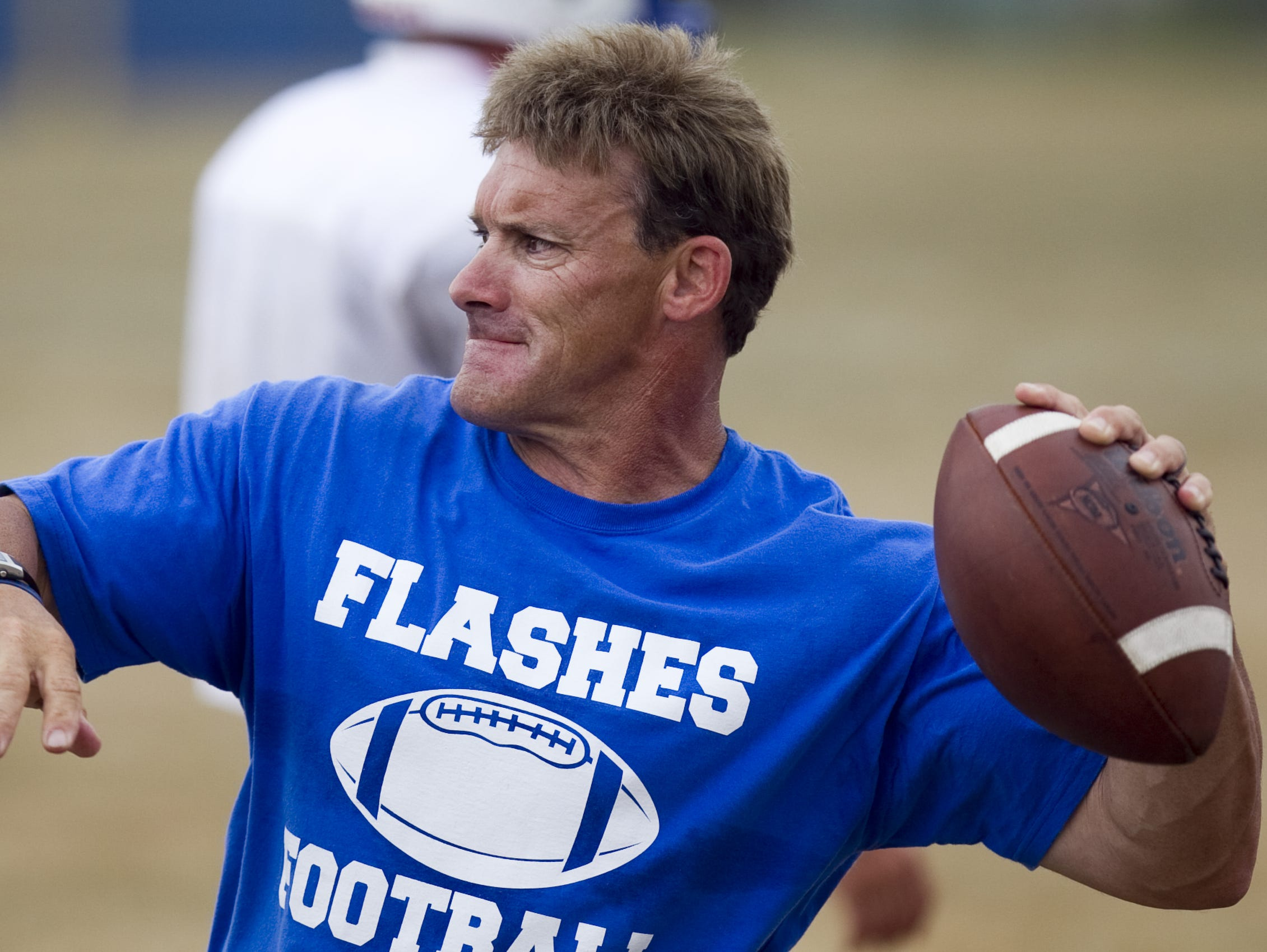 Burt Austin throws a ball to players at afternoon football practice at Franklin Central High School, Indianapolis, IN, Friday, August 5, 2011.