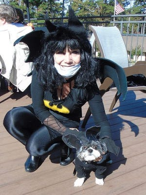 """Doggies had their own costume party at DeSoto Club. Liz Lovelace and Sophie are just a couple of """"Batgirls"""" too cute to spook."""